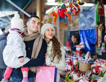 Family choosing christmas ornamentations. Stock Images