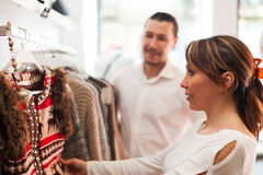 Family choosing clothes at boutique Stock Photography