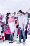 Family choosing clothes at mall Royalty Free Stock Photo
