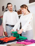 Family choosing clothes at store Stock Image