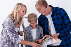 Family choosing color for wall Stock Image
