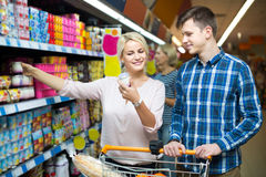 Family choosing dairy products and smiling in hypermarket Royalty Free Stock Photo