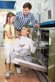 Family choosing dishwashing machine Stock Photo