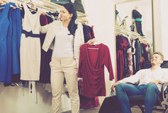 Family choosing dress and blouse at clothing shop Stock Photo