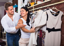 Family choosing dress and blouse at clothing shop Stock Photos