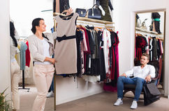 Family choosing dress and blouse at clothing shop royalty free stock image