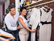 Family choosing dress and blouse at clothing shop Royalty Free Stock Photography