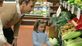 Family Choosing Fresh Vegetables In Farm Shop stock video footage