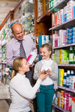 Family choosing items in pharmacy Royalty Free Stock Photo