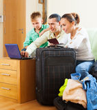 Family choosing the tickets on internet Stock Image