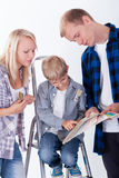 Family choosing wall color Stock Image