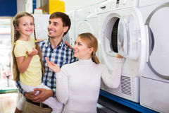 Family choosing washing machine Royalty Free Stock Images