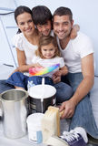 Family chosing colours to paint new house Stock Photography