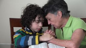 Family Christian Devotional: two generations praying