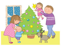 Family at Christmas. Hand drawn picture of a family dressing up the Christmas tree. Illustrated in a loose style. Vector eps available Stock Photos