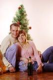 Family christmas. Adult couple near christmas tree Stock Images