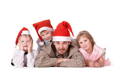 Family in Christmas caps Royalty Free Stock Images