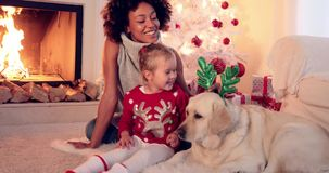 Family Christmas celebration next to fireplace stock video