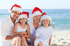 Family during Christmas day at the beach Royalty Free Stock Photo