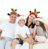 Family during Christmas day looking at the camera Stock Photography