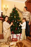 Family in Christmas decorated house Royalty Free Stock Image