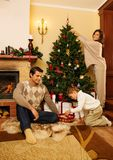 Family in Christmas decorated house Stock Image