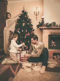 Family in Christmas decorated house Royalty Free Stock Images