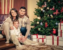 Family in Christmas decorated house Stock Images