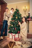 Family in Christmas decorated house interior Royalty Free Stock Photography