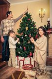 Family in Christmas decorated house interior Royalty Free Stock Photos