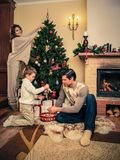Family in Christmas decorated house interior Stock Photos