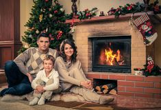 Family in Christmas decorated house interior Royalty Free Stock Photo