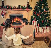 Family in Christmas decorated house interior Stock Photography