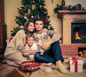 Family in Christmas decorated house interior Stock Photo