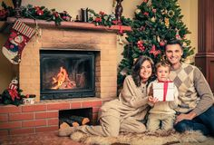 Family in Christmas decorated house interior Royalty Free Stock Image