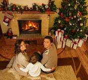 Family in Christmas decorated house Royalty Free Stock Photos