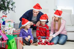 Family With Christmas Decorations And Gifts Royalty Free Stock Photo