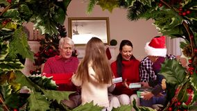 Family Christmas dinner with tree border. Digital composite of Family Christmas dinner with tree border stock footage