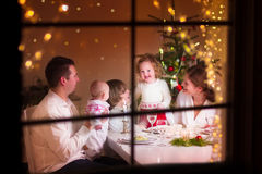 Family at Christmas dinner royalty free stock image