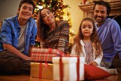 Family on Christmas eve Royalty Free Stock Photo