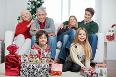 Family With Christmas Gifts In House Royalty Free Stock Photos
