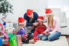 Family With Christmas Gifts And Ornaments Royalty Free Stock Photo