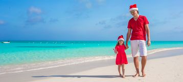Family in Christmas Hat at tropical beach Stock Photo