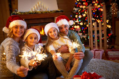 Family, Christmas, holidays and people concept - happy mother, f Stock Image