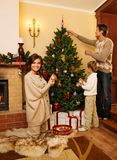 Family in Christmas house interior Royalty Free Stock Photos