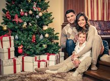 Family in Christmas house interior Royalty Free Stock Photography