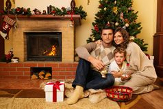 Family in Christmas house interior Royalty Free Stock Image