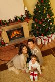 Family in Christmas house interior Royalty Free Stock Photo
