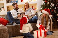 Family Christmas idyll at home. Family enjoy in idyll with children in Christmas eve stock photo