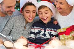 Family at Christmas opening presents. Smiling family at Christmas time at home Royalty Free Stock Photo